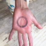 Ouroboros palm tattoo