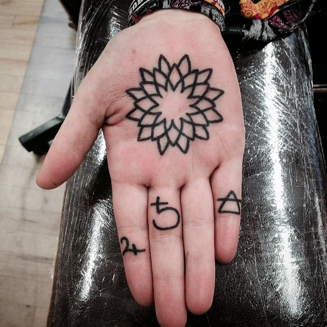 Outline mandala palm tattoo
