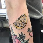Piece of lemon tattoo