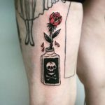 Poison bottle and red rose tattoo