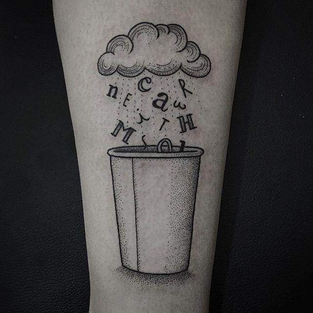Raining letters tattoo