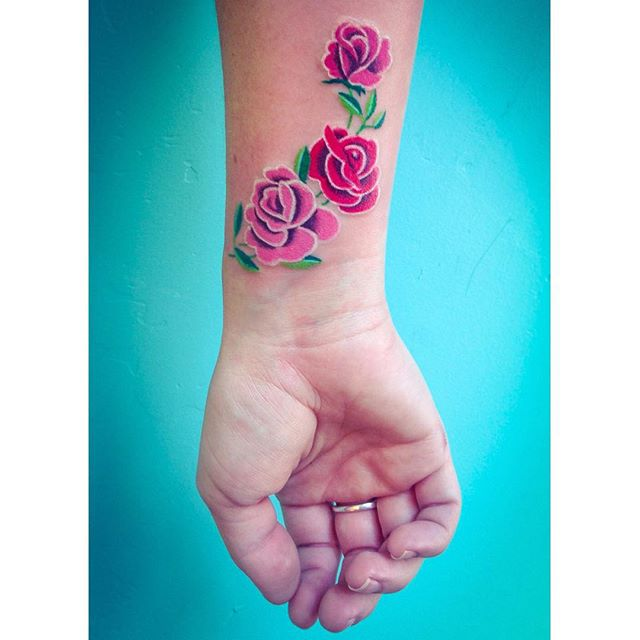 Realistic pink rose tattoo on the wrist