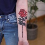 Realistic rose forearm tattoo