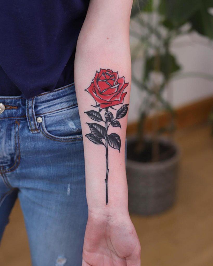 Realistic rose forearm tattoo