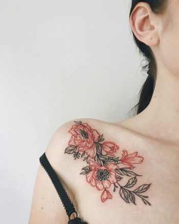 Red and black flower tattoo on the right shoulder