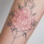 Red rose and black ornament tattoo