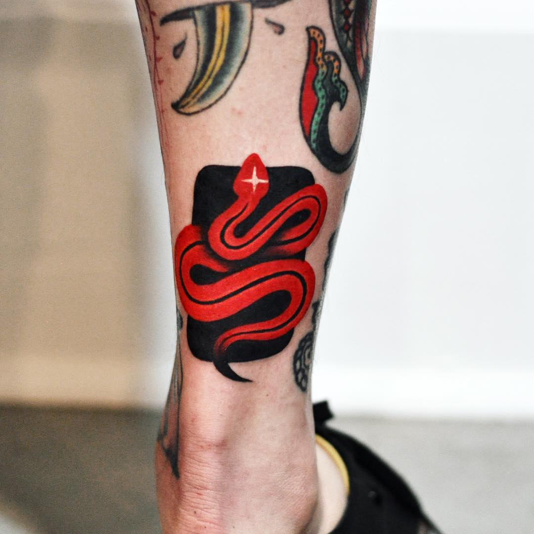 Red snake on the black background tattoo