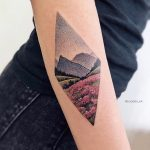 Rhombus shaped beautiful landscape tattoo