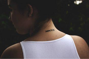 Roman numerals mmxii tattoo