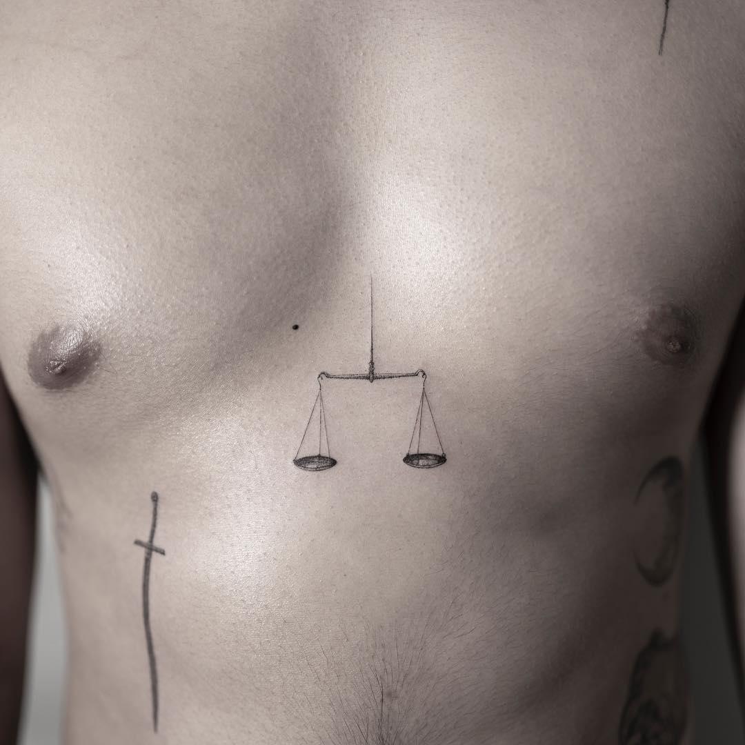 Scales sternum tattoo
