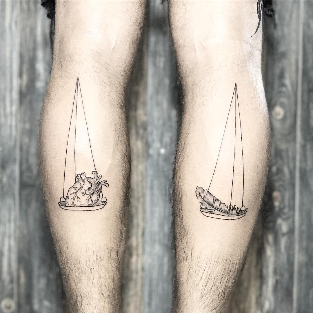 Scales tattoo on both calves
