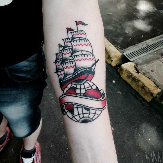 Ship and globe tattoo