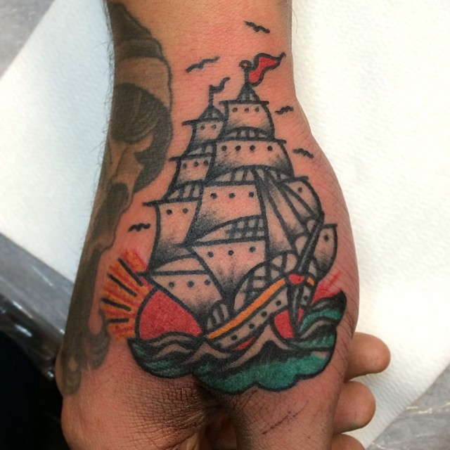 Ship tattoo on the thumb and hand