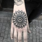 Simple black mandala on the hand