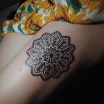 Simple black mandala tattoo on the shin