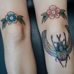 Simple flower knee tattoos