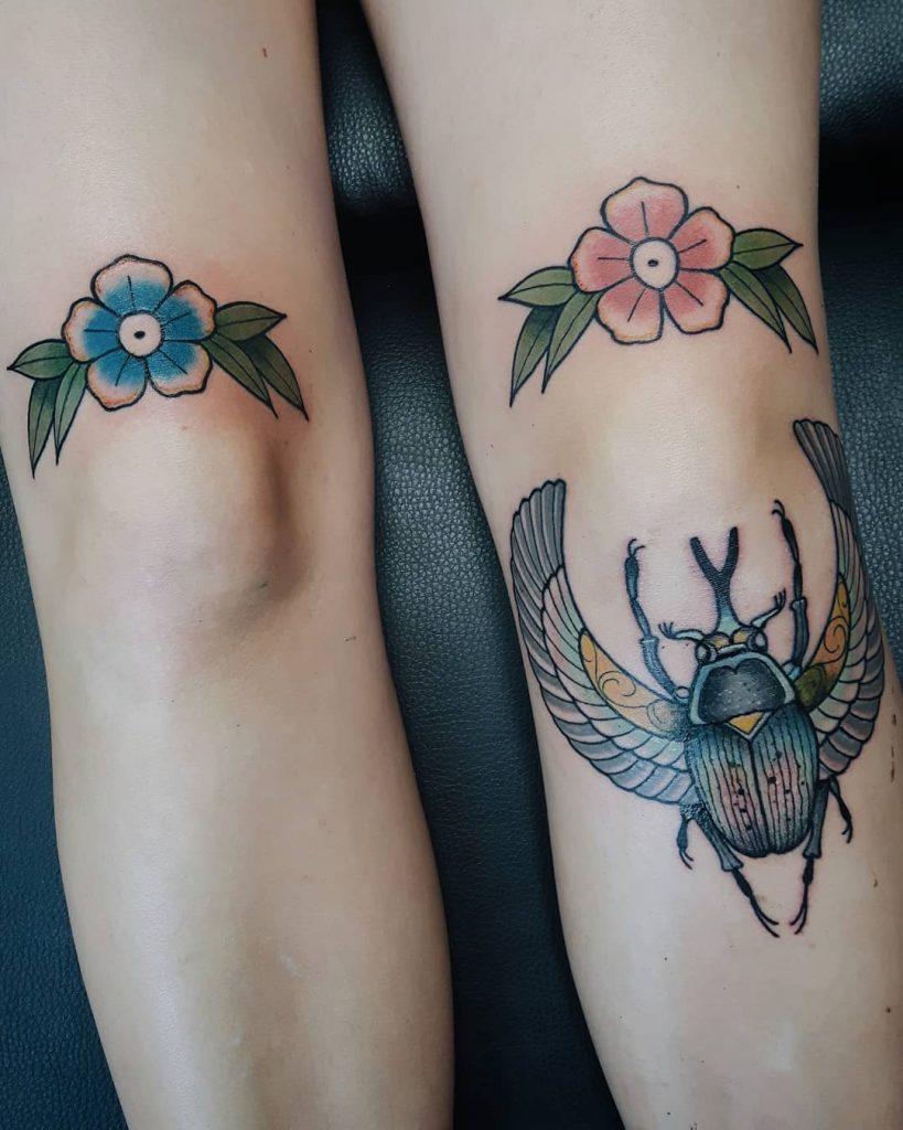 Simple flower knee tattoos