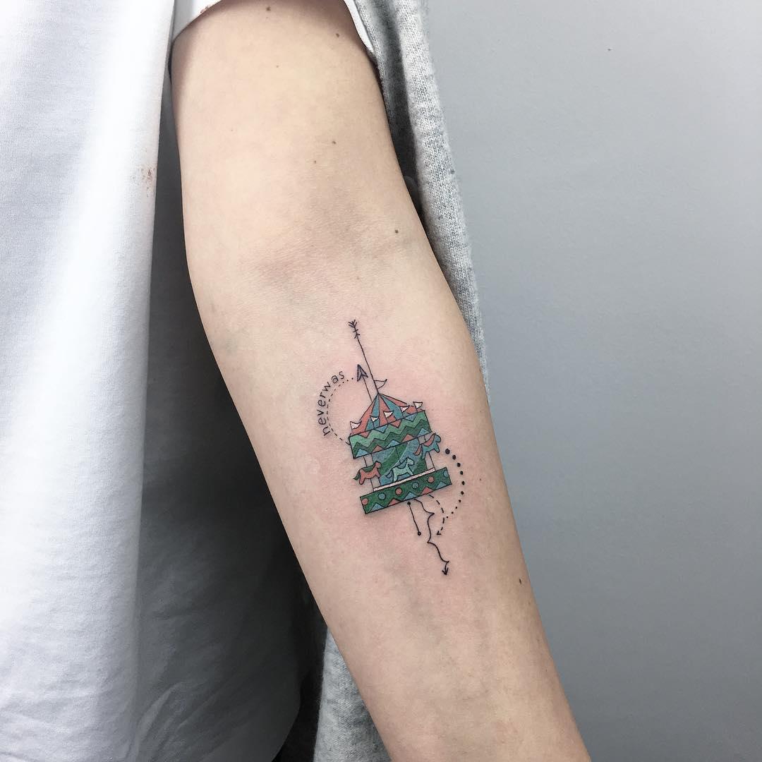 Small circus carousel tattoo