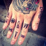 Small traditional finger tattoos