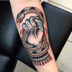 Snake handler tattoo