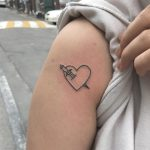 Stabbed outline heart tattoo