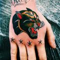 Superb traditional panther head tattoo