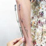 Superb wildflower forearm tattoo