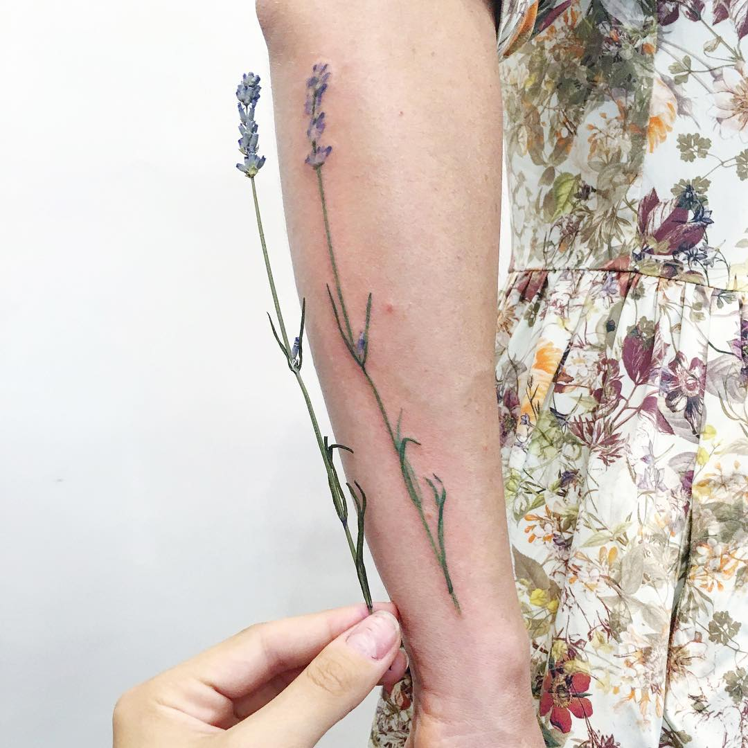 Superb wildflower forearm tattoo