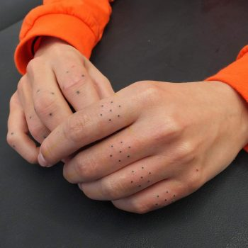 Tiny geometric finger tattoos
