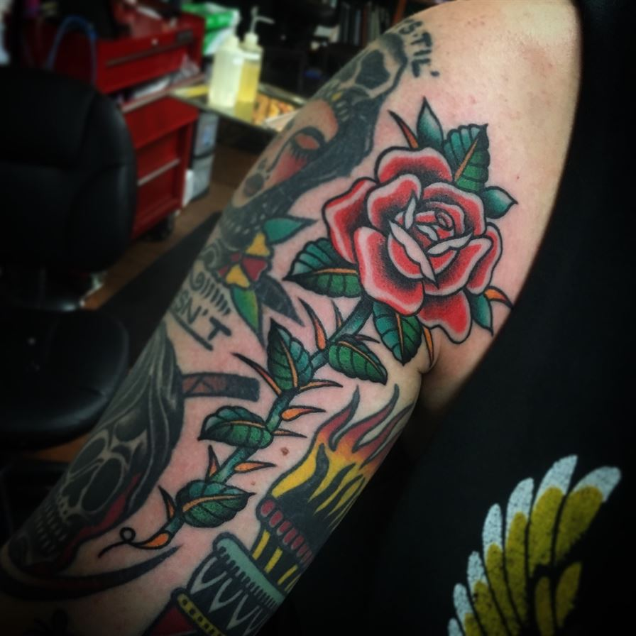 Traditional rose with thorns tattoo