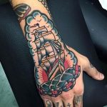 Traditional ship tattoo on the hand and forearm