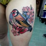 Traditional style european goldfinch tattoo