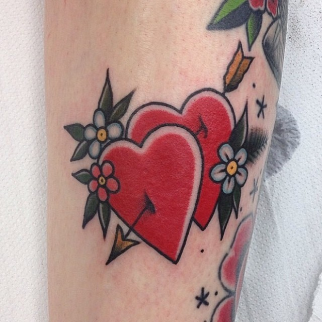 Two hearts stabbed with arrow tattoo