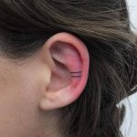 Two lines ear tattoo