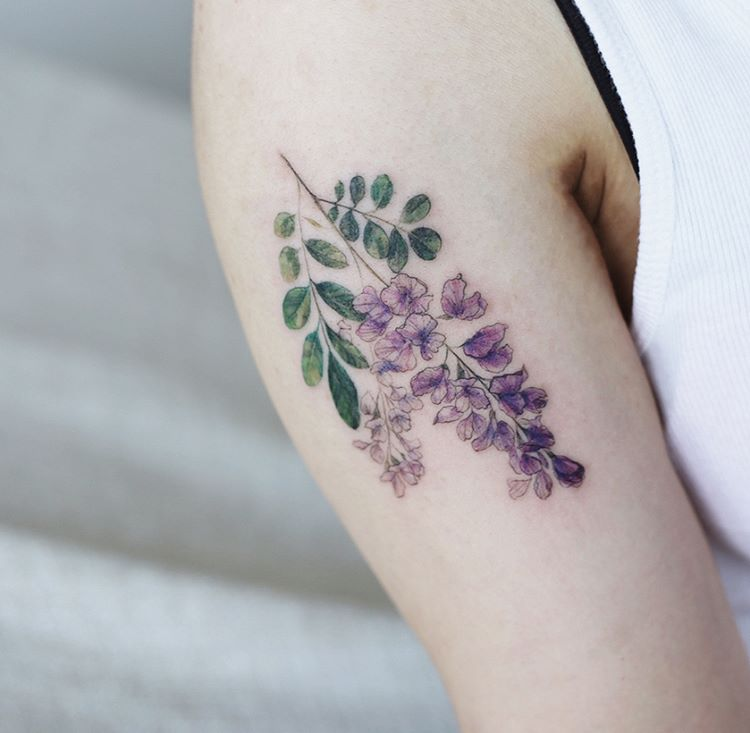 Violet and green flower tattoo