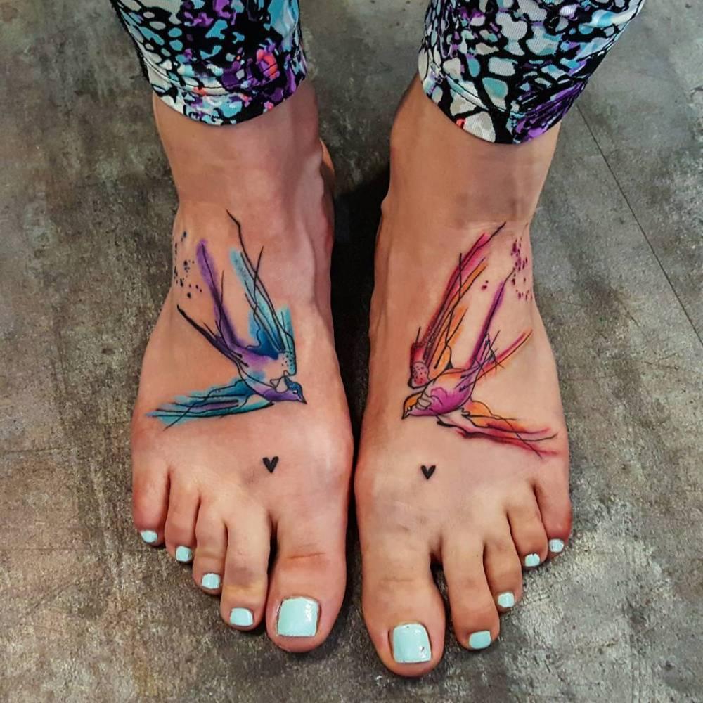 Watercolor bird tattoos on feet