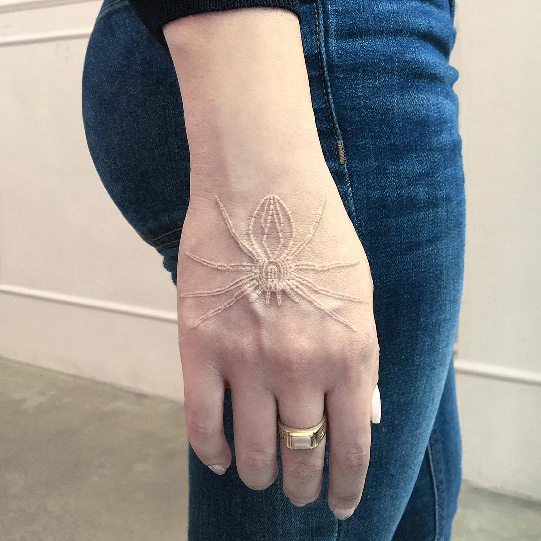 White spider tattoo