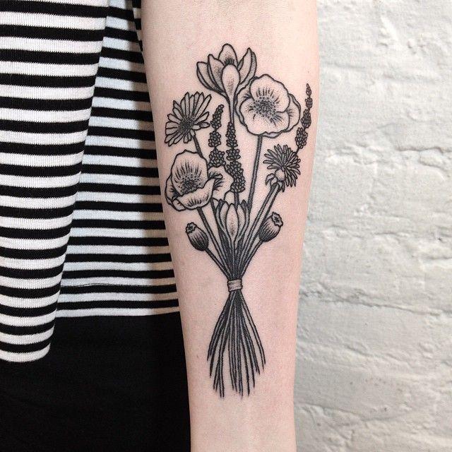 Wildflower bundle tattoo on the forearm