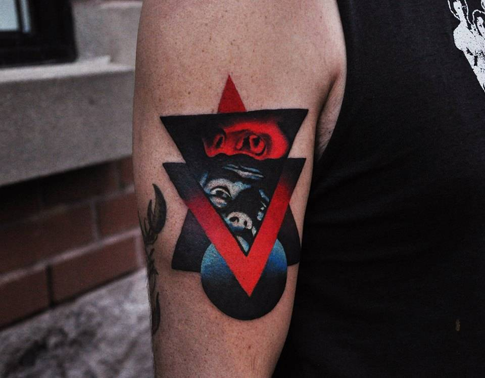 Abstract face and triangle tattoo