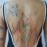 Abstract lines tattoo on the back
