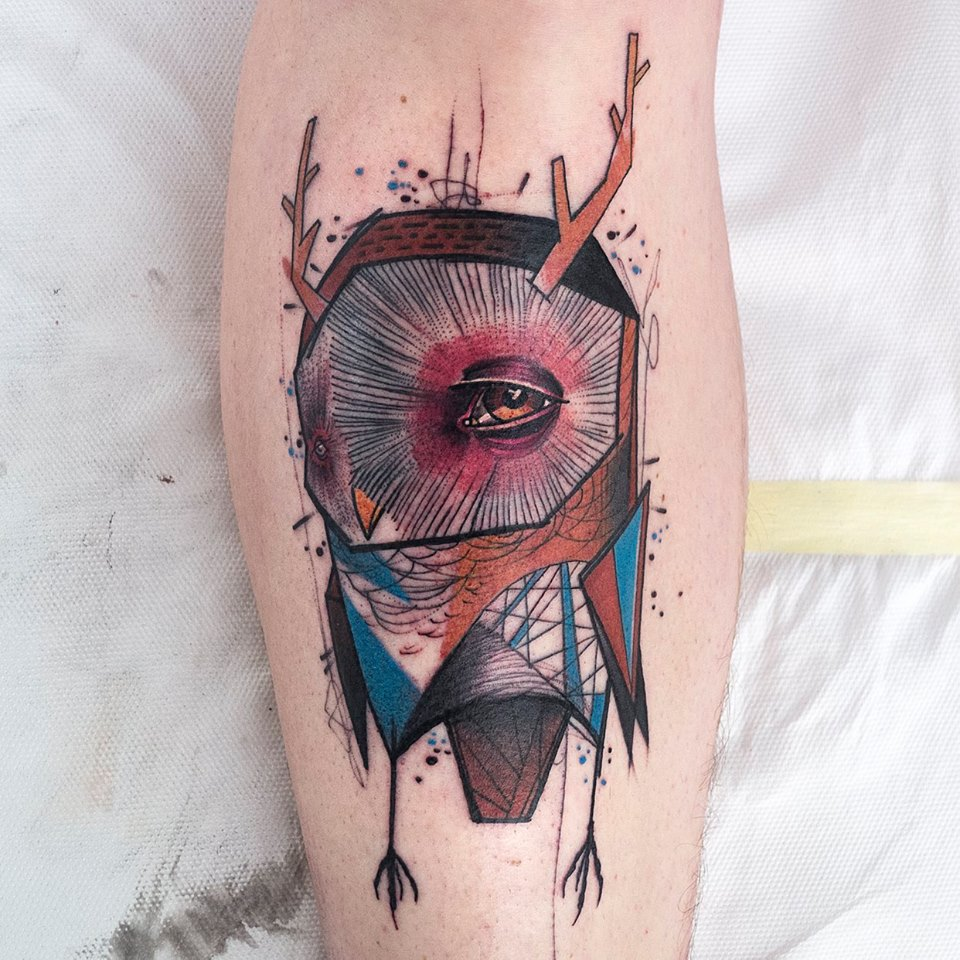 Abstract tattoo on the calf