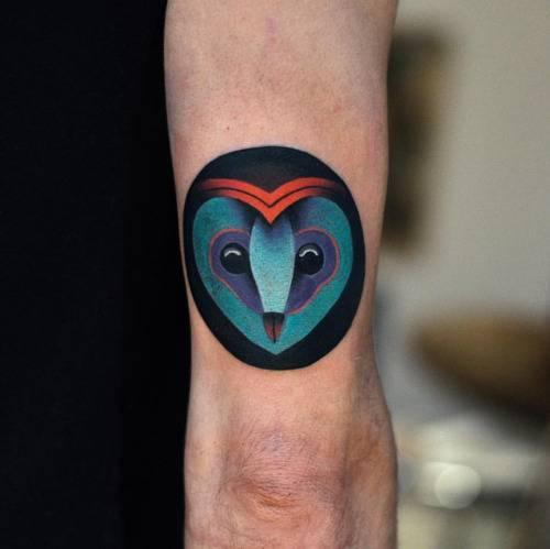 An owl head tattoo