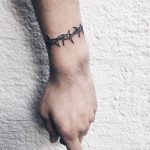 Barbed wire bracelet tattoo
