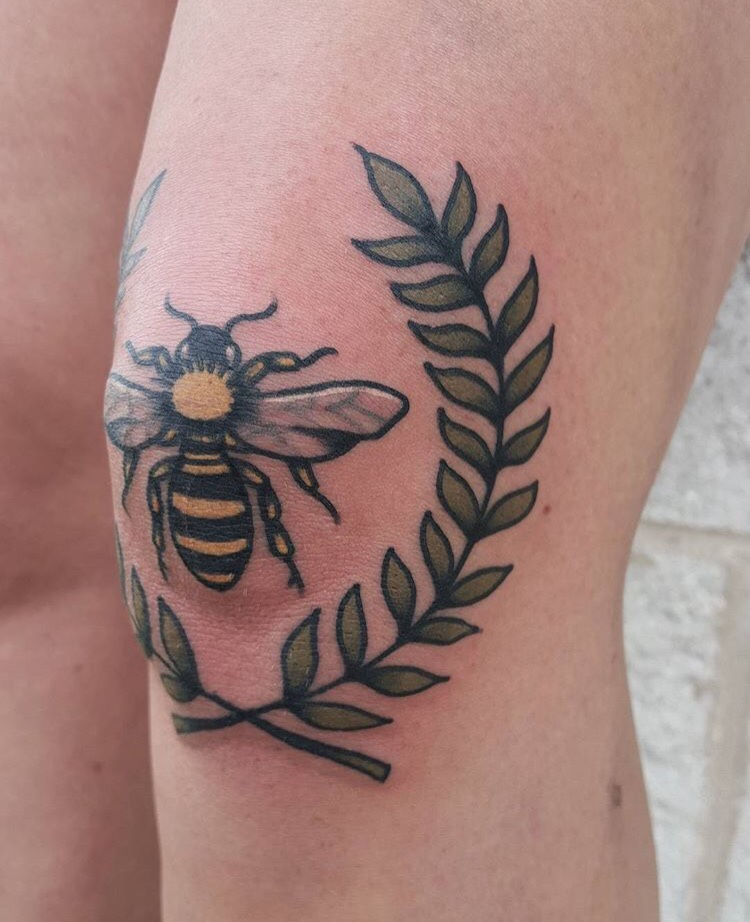 Bee and wreath tattoo on the knee