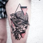 Bird on a branch and triangle tattoo