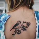 Bird on a branch tattoo
