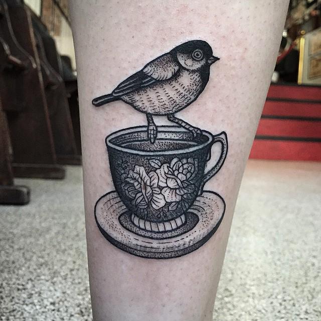 Bird on a cup tattoo