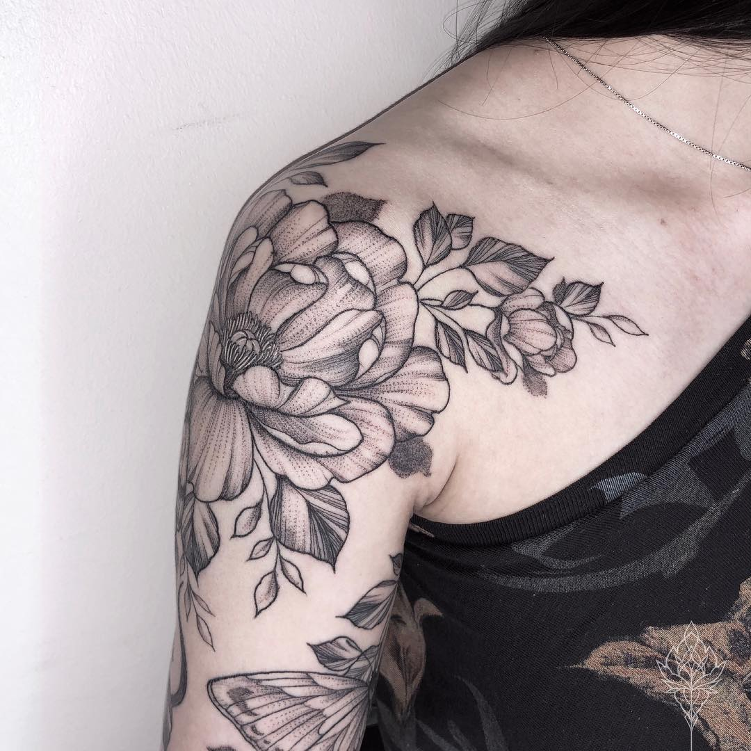 Black and gray flower tattoo on the shoulder