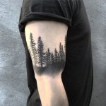 Black forest bicep tattoo