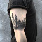 Black forest bicep tattoo